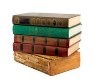 A stack of old books with gold stamping Royalty Free Stock Photo