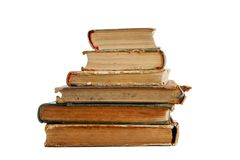 Stack of old books isolated. Stack of old books seen from ends isolated Royalty Free Stock Image