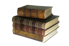 A stack of old books isolated. A stack of four ancient books isolated Royalty Free Stock Photography