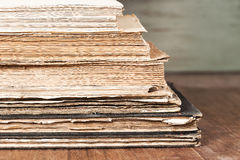 Stack of old books. Isolated on wooden table Royalty Free Stock Images