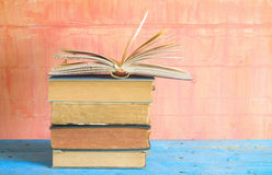 Stack of old books with one opened Royalty Free Stock Photos