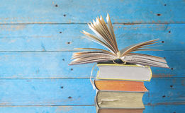 Stack of old books with one opened. Good copy space Royalty Free Stock Photography