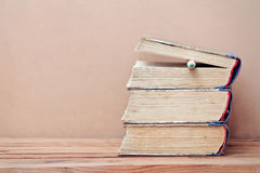 Stack of old books and pencil. On wooden table Royalty Free Stock Images