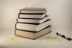 Stack of old books - question and answer royalty free stock photography