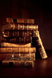 Stack of old books with reading glasses Royalty Free Stock Photo