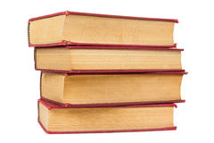 Stack of old books with red covers Stock Photos