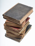 Stack of old books reflected in mirror Royalty Free Stock Photo