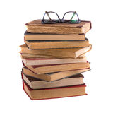Stack of old books and spectacles in thick-rimmed Royalty Free Stock Images