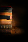 Stack of old books. With spot light Royalty Free Stock Photography
