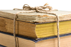 Stack of old books tied with rope Stock Image