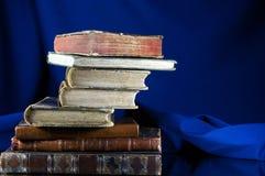 Stack of old books on velvet Stock Photography