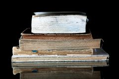 Stack of old books with vintage pages reflected Stock Photography