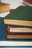 Stack of old books on white Stock Image