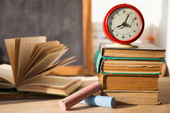 Stack of old books on wood desk Stock Images