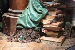 Stack of old books with green curtain Stock Photos