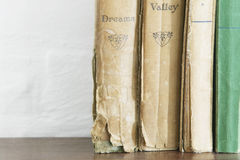 Stack of old books on wooden chest close up Royalty Free Stock Photography