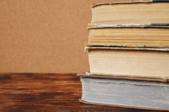 Stack of old books. On wooden table Royalty Free Stock Images