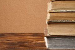 Stack of old books. On wooden table Stock Image