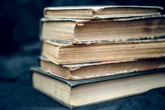 A stack of old books. A stack of old worn books on a background of dark fabric Royalty Free Stock Photography