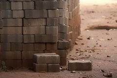 Stack of old bricks. With loose ones scattered in foreground royalty free stock photography