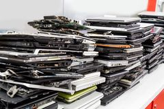 Stack of old, broken and obsolete laptop computer for repair. Stack of old, broken and obsolete laptop pc computer for repair and recycle stock photo