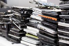Stack of old, broken and obsolete laptop computer for repair. Stack of old, broken and obsolete laptop pc computer for repair and recycle royalty free stock images