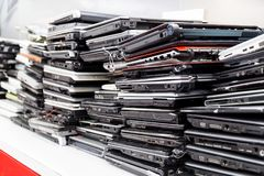 Stack of old, broken and obsolete laptop computer for repair stock images