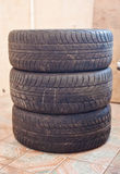 Stack of old car tire with erased tread.  Royalty Free Stock Images