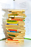 Stack of Old Children's Books. A large stack of children's books against the background of an open book Stock Photography