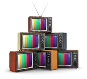Stack of old color TV. Creative abstract communication media and television business concept: stack or pile of old retro color wooden home TV receiver sets with Stock Images