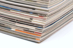Magazines stack. Stack of old colored magazines on white background Stock Images