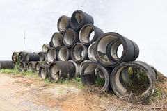 Stack of old concrete drain pipes. The stack of old concrete drain pipes at construction site Royalty Free Stock Photography