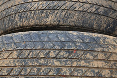 Stack of old crack car tire with brown dirt Royalty Free Stock Images
