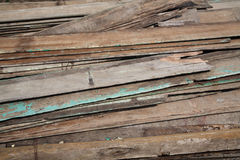 Stack of old and dirty lumber Stock Photo