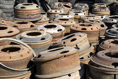 Stack of old discarded wheels. In a junk yard Stock Image