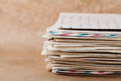 Stack of old envelopes and letters on kraft paper Stock Image