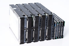 Stack of old hard drives on white background Stock Photo