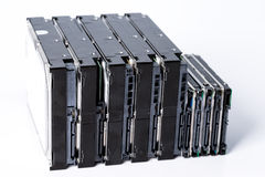 Stack of old hard drives on white background Stock Images
