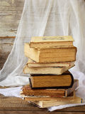 Stack of old hardback books on wooden background. Selective focus royalty free stock photos