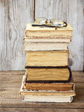 Stack of old hardback books on wooden background. Selective focus royalty free stock images
