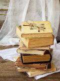 Stack of old hardback books on wooden background. Selective focus. Copy space royalty free stock image