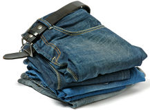 Stack of Old jeans and Belt. Isolated on white background Royalty Free Stock Photo