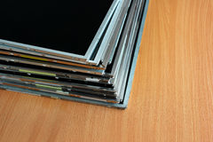Stack of old lcd and tft panels on wooden table Stock Photos