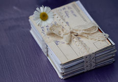 Stack of old letters with chamomile Stock Photo