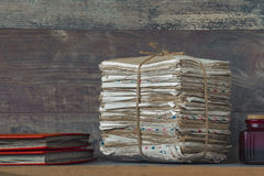 A stack of old letters and photo albums Stock Images