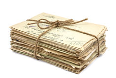Stack of old letters. On white background royalty free stock image