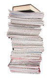 Stack of old magazines and a book Stock Photo