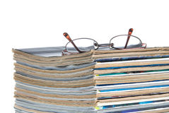Stack of old magazines & reading glasses Stock Photography