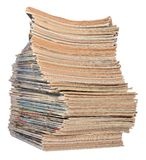 Stack of old magazines on a white Stock Image