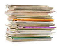 Stack of old magazines on white Stock Images